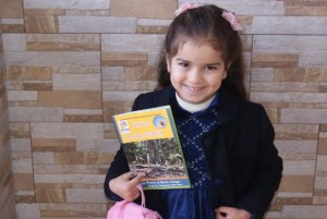 Little girl with Teshta book